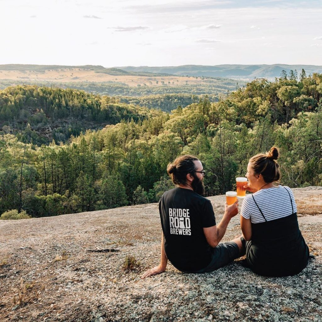 Couple with Bridge Road Brewers T-Shirt on mountain